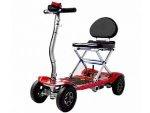 A comfortable and flexible folding mobility scooter, entering a trunk